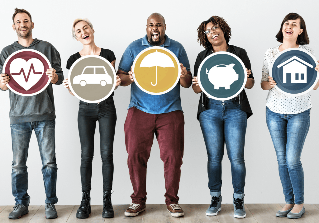 Five people celebrating financial empowerment by holding up icons of common financial goals.